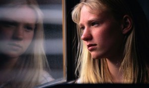Girl looking out bus window